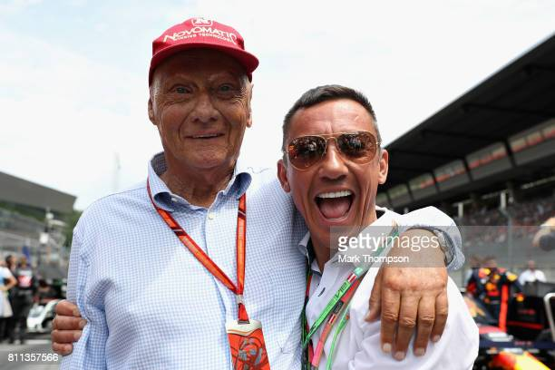 Mercedes GP nonexecutive chairman Niki Lauda poses for a photo with jockey Frankie Dettori on the grid before the Formula One Grand Prix of Austria...