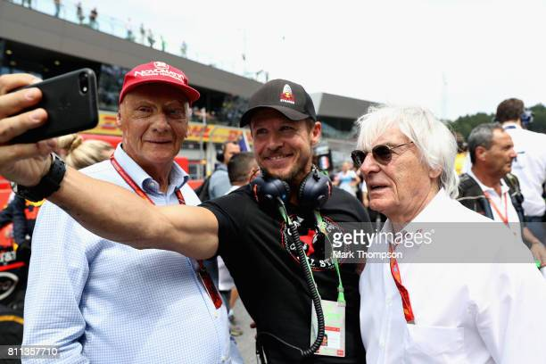 Mercedes GP nonexecutive chairman Niki Lauda poses for a photo with Felix Baumgartner and Bernie Ecclestone Chairman Emeritus of the Formula One...