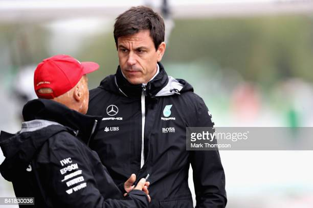 Mercedes GP nonexecutive chairman Niki Lauda talks with Mercedes GP Executive Director Toto Wolff in the Pitlane during qualifying for the Formula...