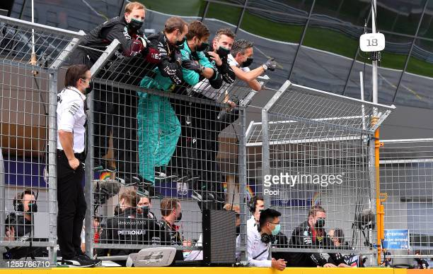 Mercedes GP team members are seen on the pit wall as they celebrate after the Formula One Grand Prix of Styria at Red Bull Ring on July 12, 2020 in...