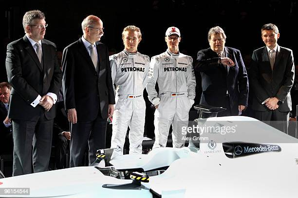 Mercedes GP team principal Ross Brawn Dieter Zetsche CEO of Daimler AG drivers Nico Rosberg and Michael Schumacher Norbert Haug head of Mercedes...