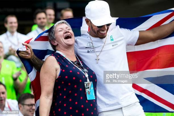 Mercedes' Lewis Hamilton celebrates winning the Formula One drivers' championship with him mum Carmen Larbalestier after the Mexican Grand Prix at...