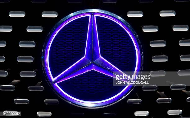 A Mercedes logo adorns the grill of a Mercedes Benz F 015 Luxury in Motion self driving car on display in a showroom during German luxury car...