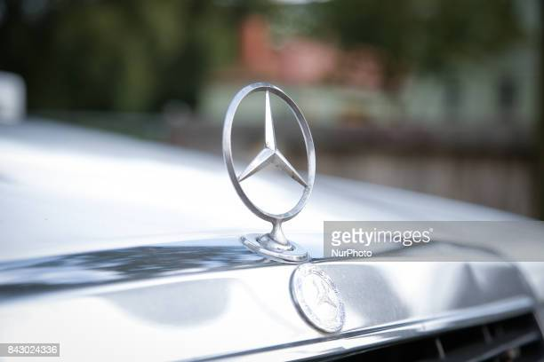 Mercedes logos are seen on the front of an older MercedesBenz car on 2 September 2017