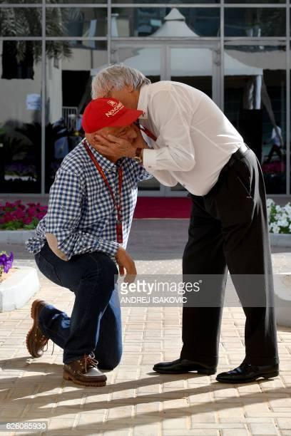 Mercedes nonexecutive chairman and former multiple world champion Niki Lauda and F1 supremo Bernie Ecclestone have fun ahead of the start of the Abu...