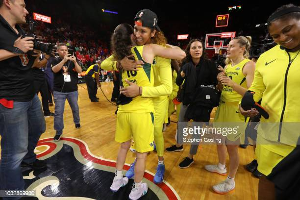 Mercedes Russell and Sue Bird of the Seattle Storm hug on court after winning Game Three of the 2018 WNBA Finals against the Washington Mystics on...