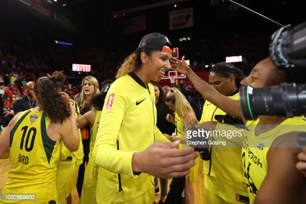 Mercedes Russell of the Seattle Storm smiles after winning Game Three of the 2018 WNBA Finals against the Washington Mystics on September 12 2018 at...