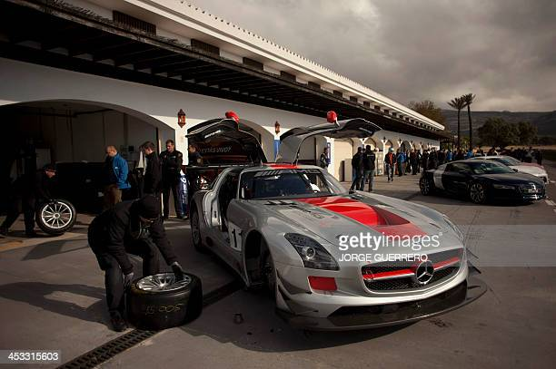 A Mercedes SLS is displayed at Ascari racetrack during the launch of racing video games Gran Turismo 6 in Ronda on December 3 2013 AFP PHOTO/ JORGE...