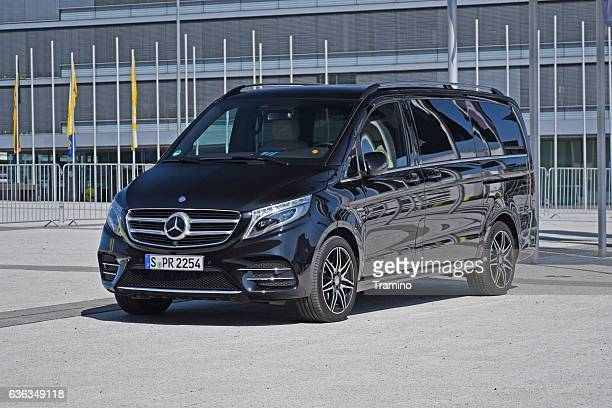 mercedes v-class on the parking - mini van stock photos and pictures