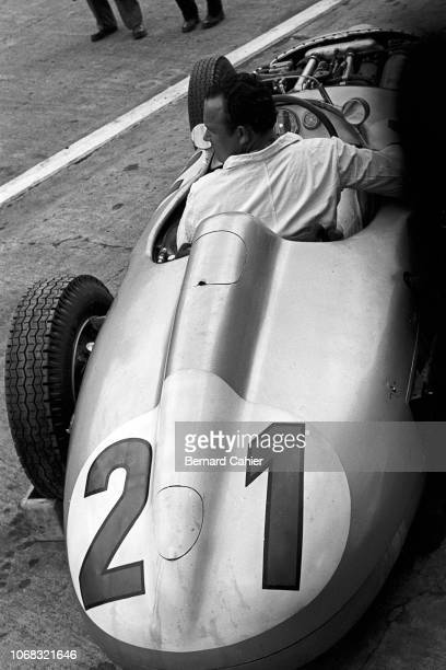 Mercedes W196, Grand Prix of Germany, Nurburgring, 01 August 1954. A mechanic from the Mercedes team sits in the W196 car during practice for the...