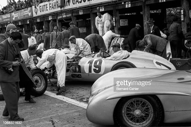 Mercedes W196, Grand Prix of Germany, Nurburgring, 01 August 1954. The Mercedes team during practice for the 1954 Grand Prix of Germany at the...