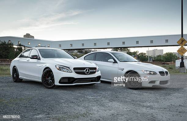 mercedes-amg c63 s and bmw m3 - bmw stock pictures, royalty-free photos & images