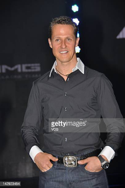 MercedesAMG driver Michael Schumacher of Germany attends the MercedesBenz C63 AMG launch at Shanghai World Expo Park on April 14 2012 in Shanghai...