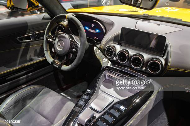 Mercedes-AMG GT Roadster open convertible sports car on display at Brussels Expo on January 9, 2020 in Brussels, Belgium. The car is equipped with a...