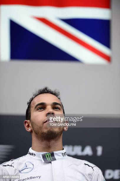 MercedesAMG's British driver Lewis Hamilton celebrates on the podium after the Spanish Formula One Grand Prix at the Circuit de Catalunya in Montmelo...