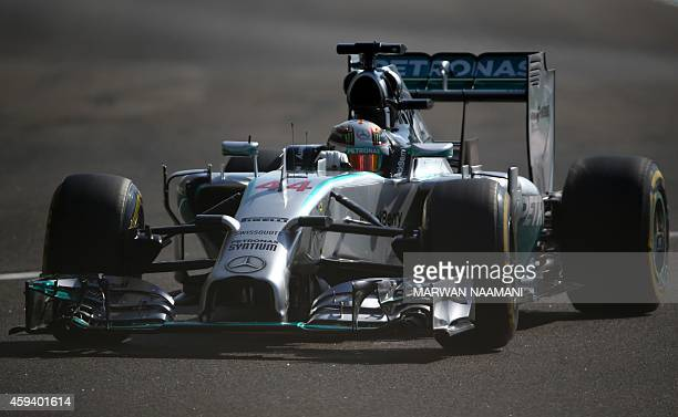 MercedesAMG's British driver Lewis Hamilton drives during the third practice session at the Yas Marina circuit in Abu Dhabi on November 22 2014 ahead...