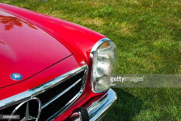 mercedes-benz 280sl pagoda, front detail against green grass - mercedes stock photos and pictures