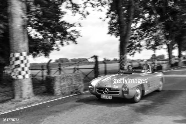 mercedes-benz 300 sls roadster classic lightweight racing car driving on a country road - mercedes benz 300sl stock photos and pictures