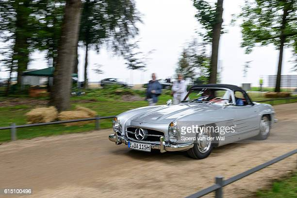 mercedes-benz 300sl convertible classic car driving - mercedes benz 300sl gullwing stock photos and pictures
