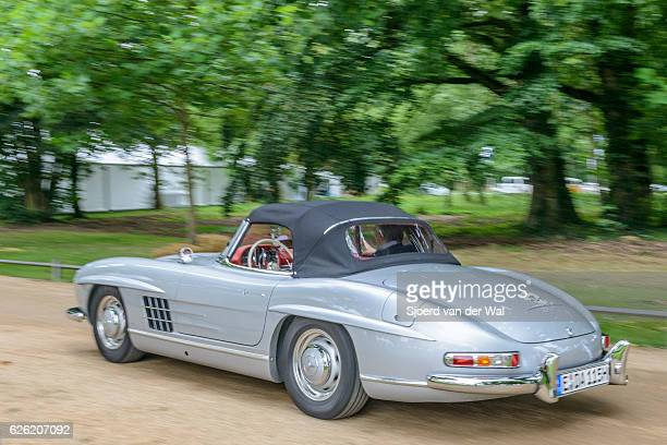 mercedes-benz 300sl convertible driving by - mercedes benz 300sl gullwing stock photos and pictures