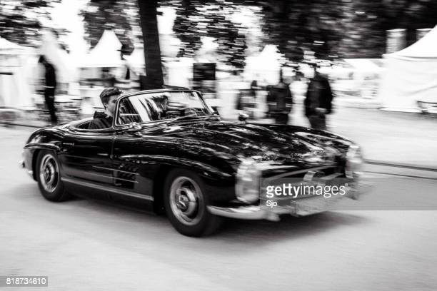 mercedes-benz 300sl convertible driving fast - mercedes stock photos and pictures