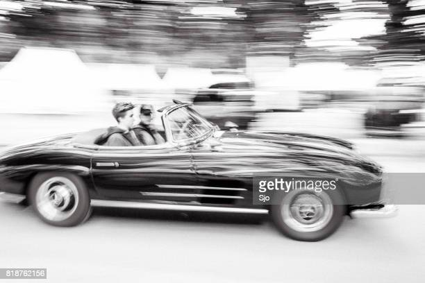 mercedes-benz 300sl convertible driving fast - mercedes benz 300sl stock photos and pictures