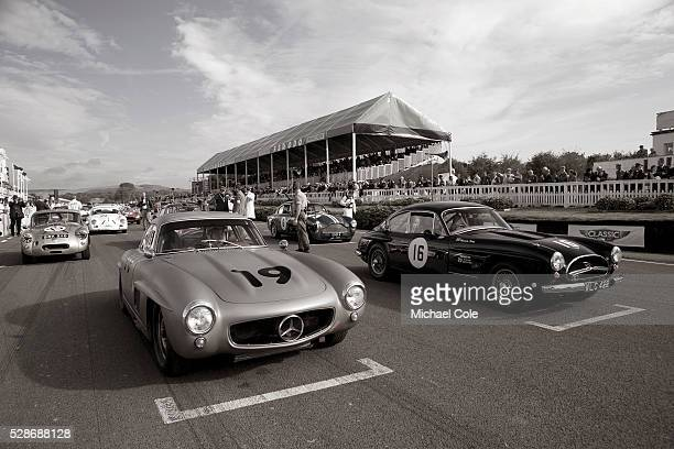 MercedesBenz 300SL 'Gullwing' 1958 Jensen 541R on starting grid Fordwater Trophy at The Goodwood Revival Meeting 15th Sept 2013