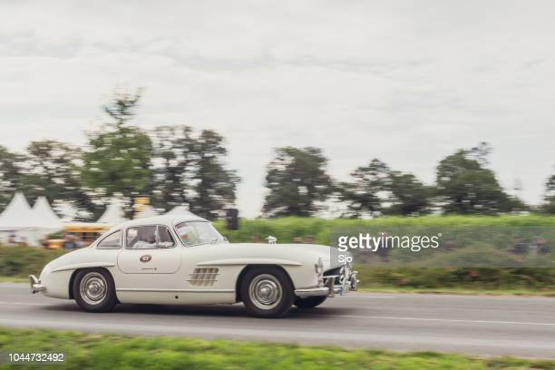 mercedes-benz 300sl gullwing classic sports car driving - mercedes benz 300sl stock photos and pictures