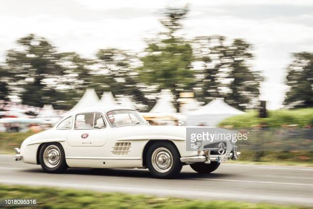 mercedes-benz 300sl gullwing convertible classic sports car driving - mercedes benz 300sl stock photos and pictures