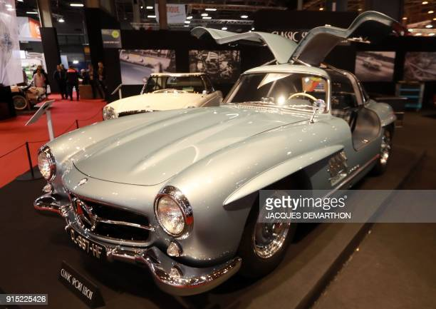 A MercedesBenz 300SL papillon from 1954 is seen on display at Retromobile an exhibition of vintage motor vehicles at Paris Expo in Porte de...