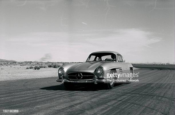 MercedesBenz 300SL Road Test Track testing involved a day at the Willow Springs Raceway in Rosamond California Front 3/4 view of Mercedes entering...