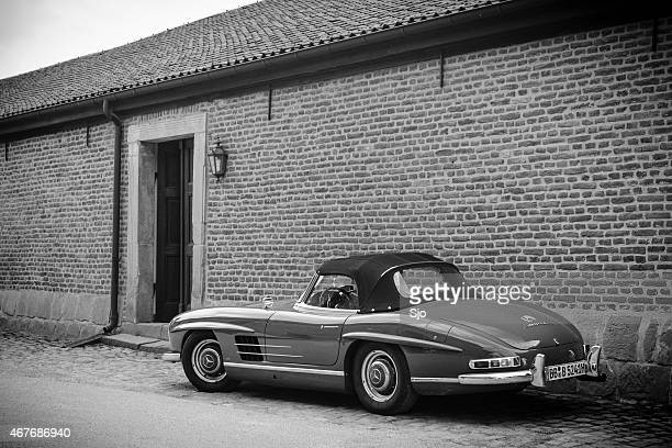 mercedes-benz 300sl roadster classic sports car in black and white - mercedes benz 300sl stock photos and pictures