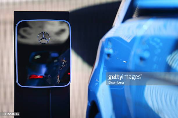 Mercedes-Benz AG electric charging station sits on the automaker's exhibition stand during the second press day of the Paris Motor Show at Porte de...
