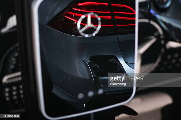A MercedesBenz AG electric charging station sits on the automaker's exhibition stand during the second press day of the Paris Motor Show at Porte de...