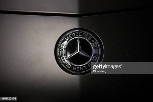 A MercedesBenz AG threepointed star badge sits on an AMG GT high performance luxury automobile after final quality checks at the automaker's plant in...