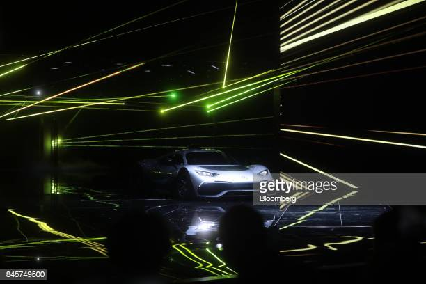 A MercedesBenz AMG Project One hypercar drives on stage during its unveiling during the Daimler AG media night ahead of the IAA Frankfurt Motor Show...