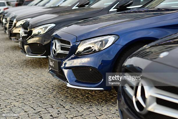 mercedes-benz cars in a row - mercedes stock photos and pictures