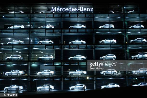 Mercedes-Benz cars stand on display at night at a Mercedes-Benz dealership on September 28, 2019 in Munich, Germany. A German state prosecutor...
