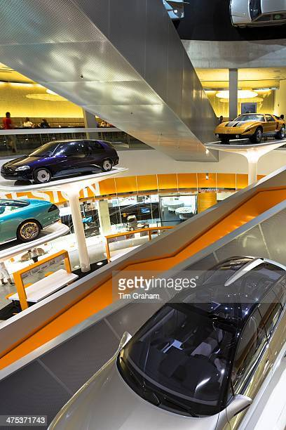 MercedesBenz concept cars in their museum gallery in Stuttgart Bavaria Germany Silver is F400 Carving V6 from 2001 orange is C111 from 1970