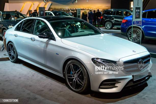 MercedesBenz Eclass E 350 e sedan plugin hybrid luxury car connected to an electric vehicle charging station on display at Brussels Expo on January...