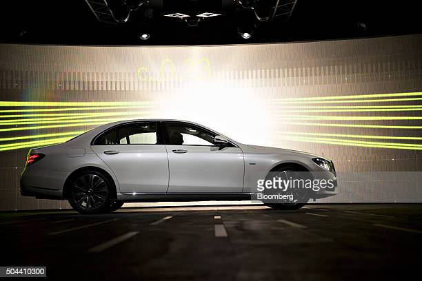 MercedesBenz EClass vehicle is driven on stage during a Daimler AG MercedesBenz event ahead of the 2016 North American Auto Show in Detroit Michigan...