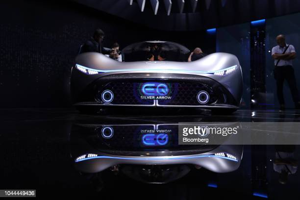 A MercedesBenz EQ Silver Arrow electric concept supercar manufactured by Daimler AG is unveiled during the Paris Motor Show in Paris France on...