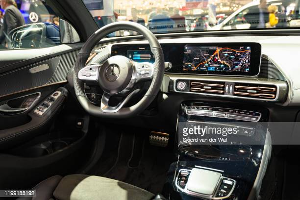 Mercedes-Benz EQC full electric compact luxury SUV car interior on display at Brussels Expo on January 9, 2020 in Brussels, Belgium. The EQC is the...