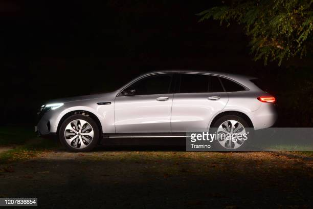 mercedes-benz eqc on a street at night - mercedes benz stock pictures, royalty-free photos & images
