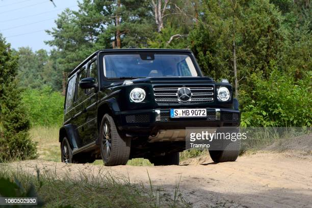 mercedes-benz g 500 on the road - mercedes stock photos and pictures