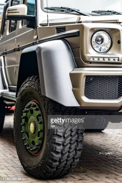 mercedes-benz g 63 amg 6x6 six-wheel-drive luxury off road vehicle - mercedes benz g class stock pictures, royalty-free photos & images