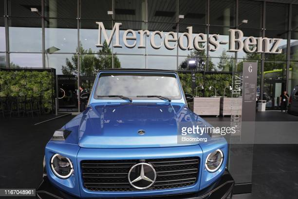 A MercedesBenz GClass offroader stands outside the Daimler AG exhibition hall ahead of the IAA Frankfurt Motor Show in Frankfurt Germany on Monday...