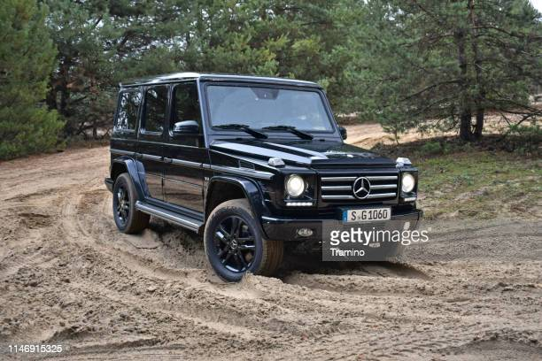 mercedes-benz g-class on the road - mercedes benz g class stock pictures, royalty-free photos & images