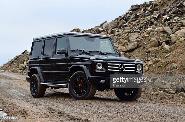 mercedes-benz g-class on the road - mercedes stock photos and pictures