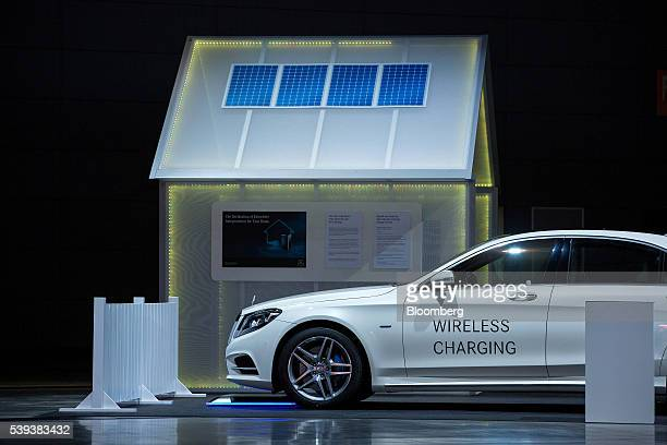 A MercedesBenz S500 hydrid automobile sits parked over a wireless electrical charging station during Daimler's TecDay Road to the Future event in...